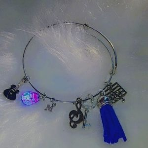 Exclusive custom made silver bracelet with charms